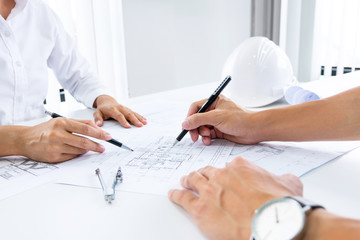 Close up of engineer hands discussing a building construction project at workplace