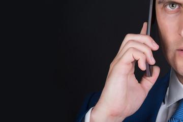 man half face talking on smartphone