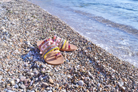 bohemian greek sandals advertisement on the beach