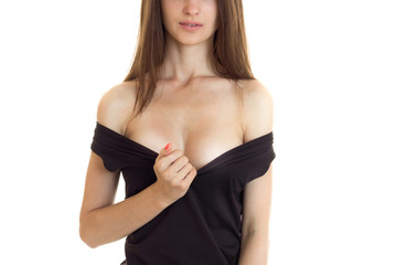 beautiful sexy breast young girl under the black dress isolated on a white background