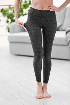 Young girl in grey pants for yoga