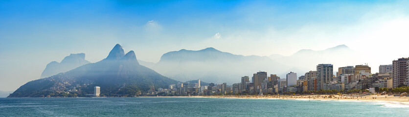 Panoramic landscape of the beaches of Arpoador, Ipanema and Leblon in Rio de Janeiro with sky and the hill Two brothers, Vidigal, and Gávea stone in the background
