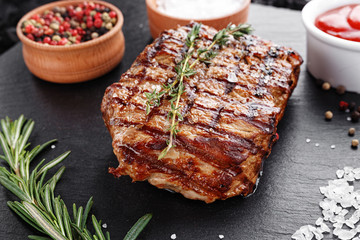 Steak cooked on a blackboard