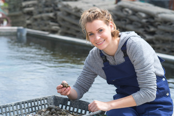 happy femake worker at fish and mussel farm