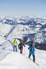 Group of people skiing on snowcapped mountain