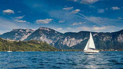 Sailing yacht against mountain range