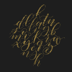 Handwritten beautiful elegant vector golden glitter calligraphy alphabet. Bush font lower cases cursive script on black background.