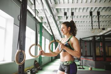 dip ring beutiful girl woman muscle ups rings workout at gym