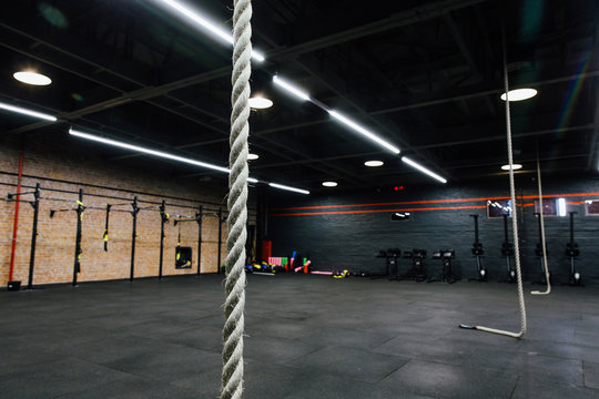 Loft big empty interior of the gym for fitness workout. Cross power training. Nobody.