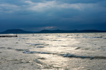 The stormy Lake Balaton with the Badacsony mountain in the background in Hungary