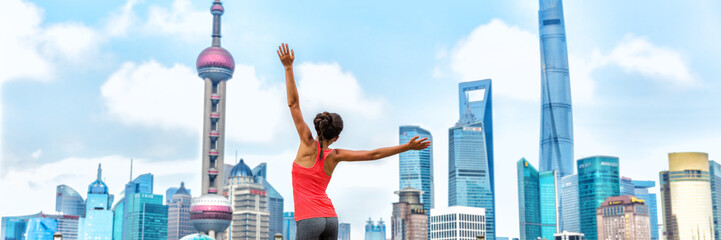 Wall Mural - City success winner jumping of joy woman on urban background banner, panorama landscape. Happy businesswoman jumping of joy on achievement career goal challenge.