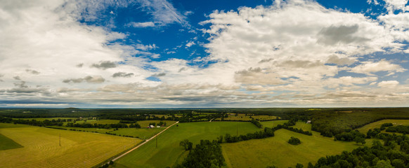 Aerial panorama of Missouri fields with large could formations