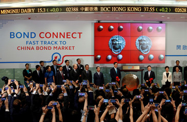 Hong Kong Chief Executive Carrie Lam, People's Bank of China Deputy Governor Pan Gongsheng and Hong Kong Monetary Authority Chief Executive Norman Chan attend the launching ceremony of Bond Connect in Hong Kong