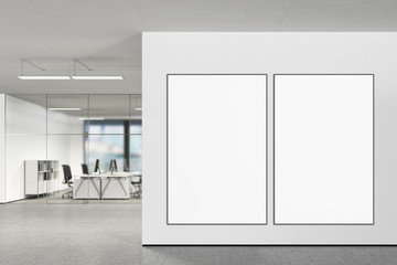 Blank poster on the wall in modern office
