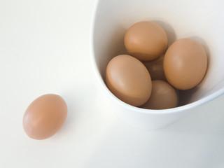 Brown Eggs in a bowl n white