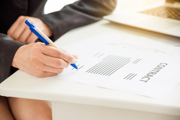 Businesswoman signing in contract document