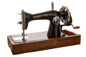 An old, hand sewing machine on white background