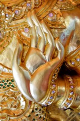 Close up Ancient Golden Hand Sculpture.