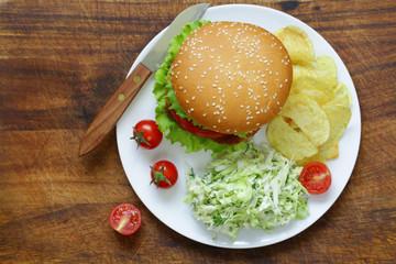 Hamburger with tomato, fresh salad and mayonnaise