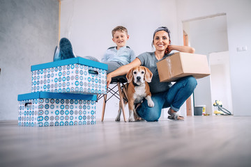 Mother wit son and dog in new apartment