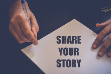 businessman write share your story on white paper