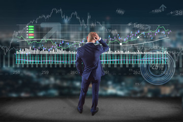 Man in front of a wall writing on a stock exchange interface - tradex concept