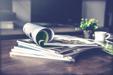 selective focus of  stacking magazine place on table in living room