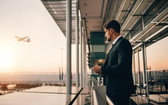Businessman at airport at sunset