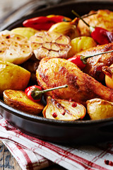 Spicy Chicken Leg with Baked Potatoes, Garlic and Chili Peppers