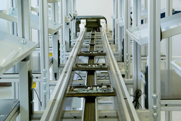 DIP elements mounting conveyor line with electronic boards