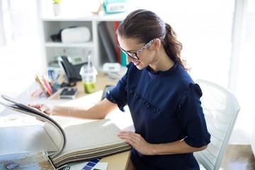 Female executive looking at sample book