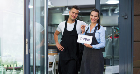 Young man and woman working at cafe