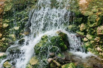 Close up of rapid stream river over rocks