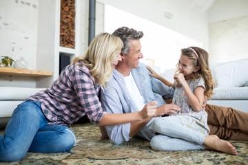 Happy family having fun in living room