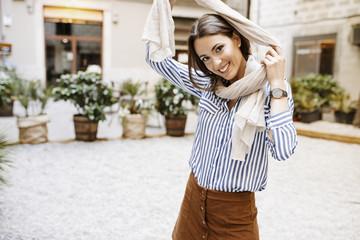 Woman in scarf in street