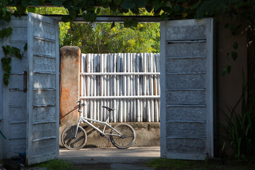 Old white Bicycle in the countryside on the background of the fence