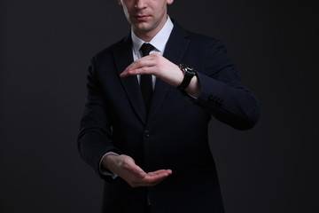 Portrait of a young businessman in a strict suit