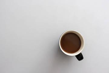 coffee cup on white table. top view