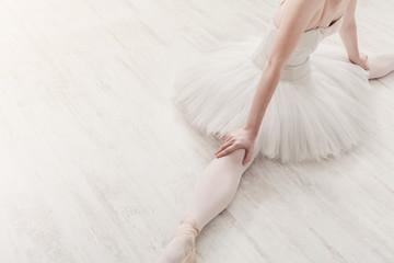 Classical Ballet dancer in split portrait, top view