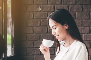Female drinking coffee in coffee shop