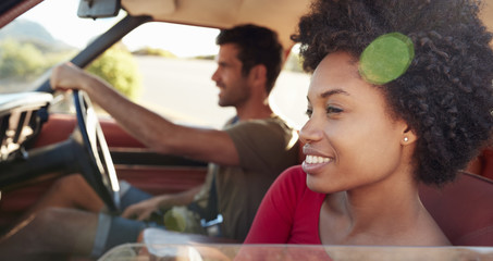 Young Couple Relaxing In Car During Road Trip