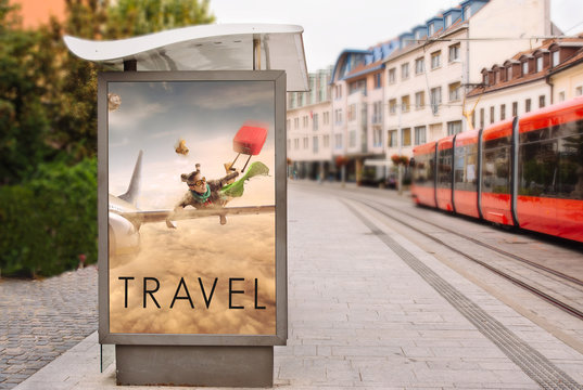 Billboards with advertising of conceptual travel. At city street