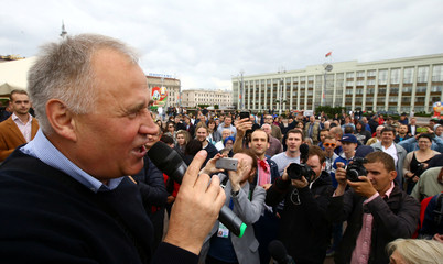 Belarusian opposition leader Statkevich delivers a speech during a protest rally on the Independence Day in Minsk