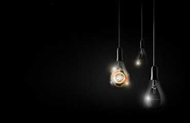 Glowing abstract futuristic light bulb is hanging between a lot of turned off light bulbs on dark black background, copy space, vector illustration