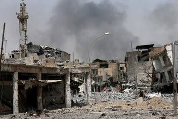 Buildings destroyed during clashes are seen during fight with the Islamic State militants in the Old City of Mosul