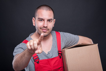 Mover man holding box gesturing touchscreen