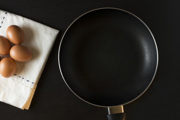 eggs with napkin on black background