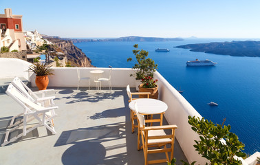 Breathtaking view of the caldera from hotel balcony in Fira, Santorini, Greece.