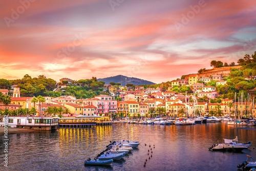 Wall mural Harbor and village  Porto Azzurro at sunset, Elba islands, Tuscany, Italy.