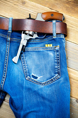 revolver under a leather belt
